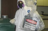 disposal of asbestos, guy holding asbestos