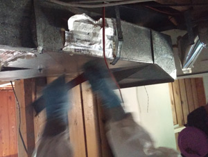 worker removing hvac ducting